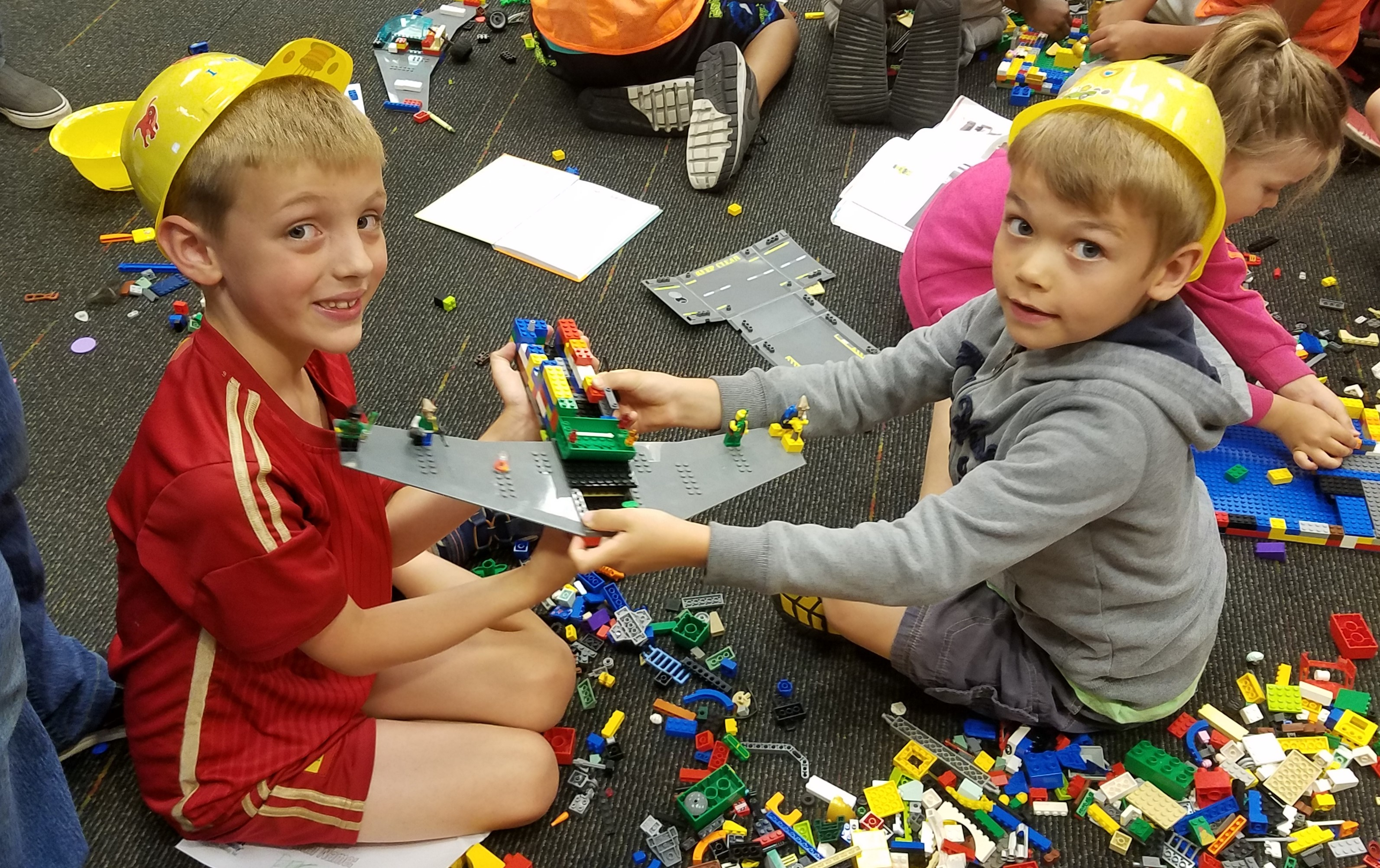 Children building a house of out Legos.